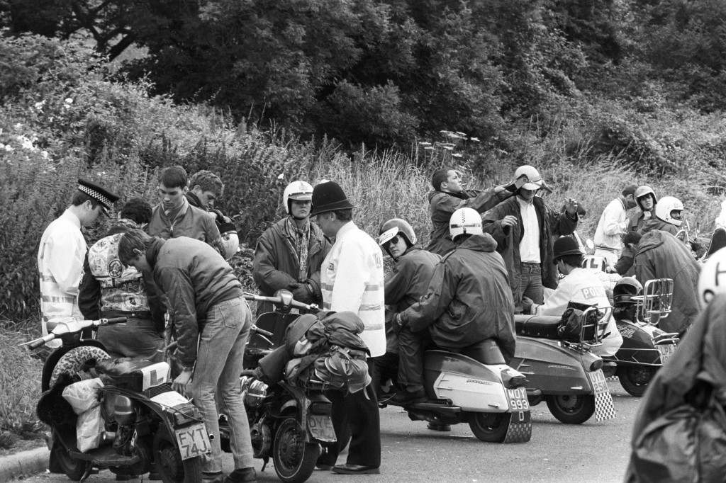 Police searching scooters, riders and passengers on the A23 into Brighton today, after reports that Mods were to hold a 'Lambretta Rally' there. Date: 08/08/1981