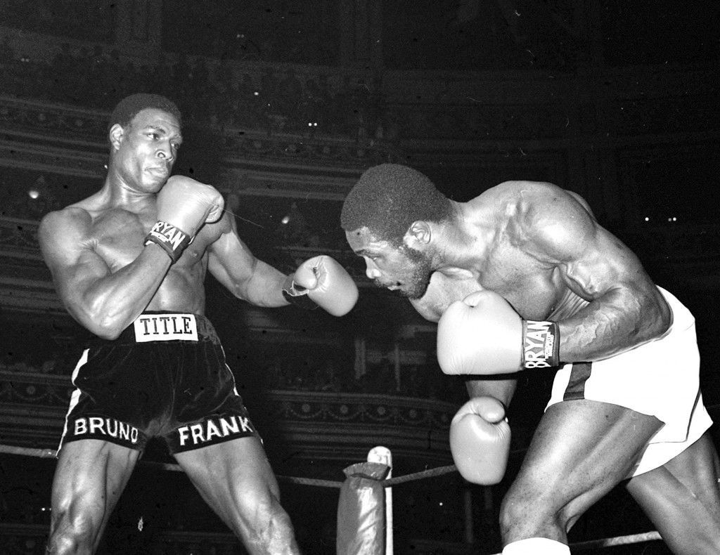 "Britain's unbeaten heavyweight Frank Bruno (left) -- 19 wins inside the distance, attacks opponent Floyd ""Jumbo"" Cummings of America during tonight's 10-round contest at the Royal Albert Hall, London which the London man won in the 7th round. Ref #: PA.1649917  Date: 11/10/1983"