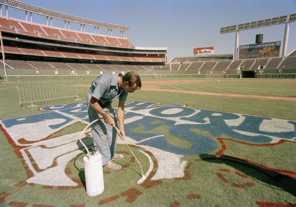 A groundskeeper at Jack Murphy Stadium paints the logo for the 1984 World Series between San Diego Padres and Detroit Tigers in San Diego October 1984. (AP Photo) Ref #: PA.17072325  Date: 01/10/1984