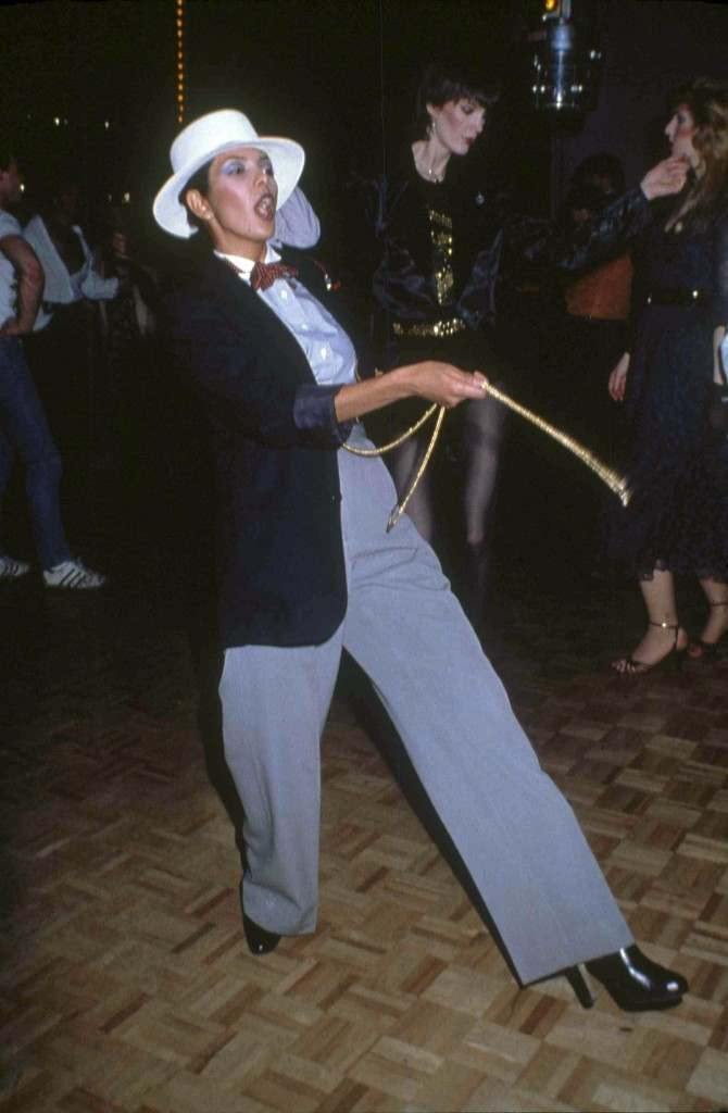 An unidentified woman in a Zoot Suit struts her stuff on the floor of New York's Studio 54. (AP Photo) Ref #: PA.17557220 Date: 01/03/1979