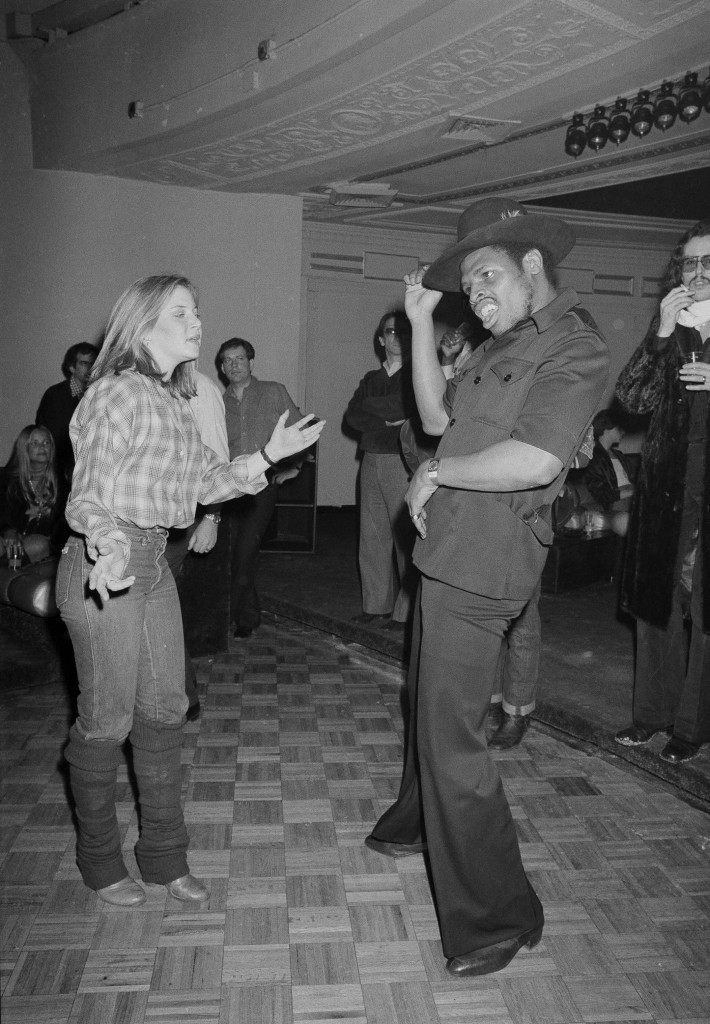 Leon Spinks, the new heavyweight champion of the world, dances at Studio 54 in New York, Feb. 22, 1978, with Lisa Dawn Gold of Philadelphia. (AP Photo) Ref #: PA.17590636 Date: 22/02/1978
