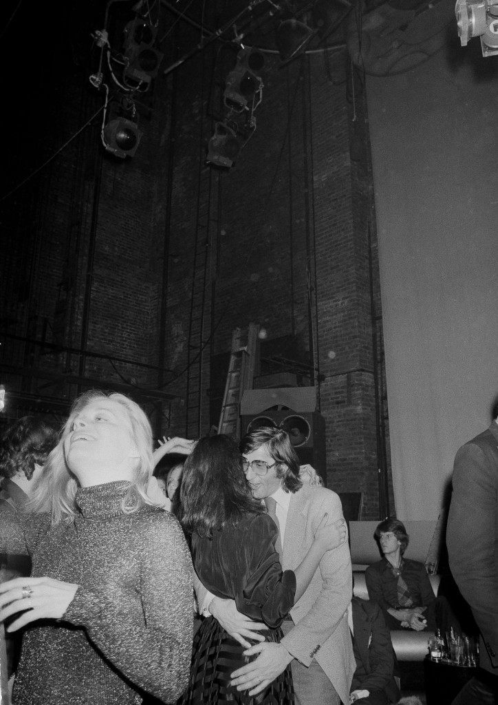 Romanian tennis star Ilie Nastase takes to the dance floor, Jan. 6, 1978, at New York's Studio 54 disco. He wears the eyeglasses of an unidentified partner, who put them down as a joke while they danced. Nastase said it was his first visit to the night club. (AP Photo)