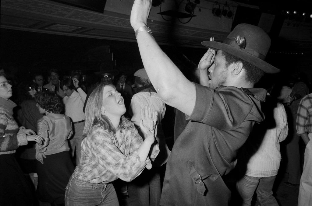 Leon Spinks, the new heavyweight champion of the world, dances at Studio 54 in New York, Feb. 22, 1978, with Lisa Dawn Gold of Philadelphia. (AP Photo) Ref #: PA.17590641 Date: 22/02/1978