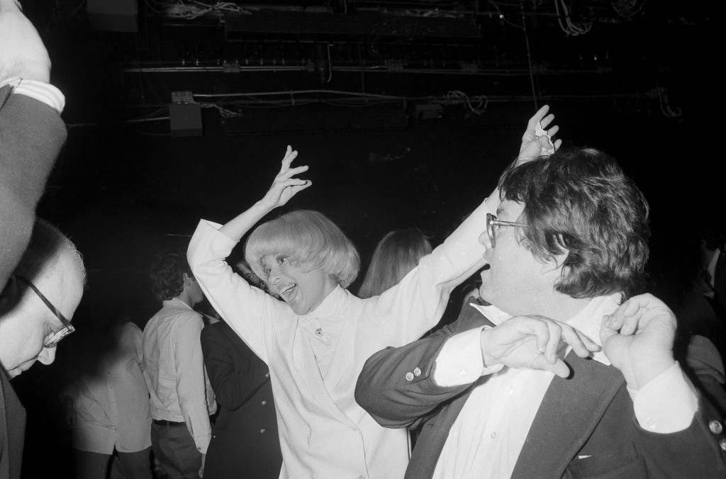"Actress Carol Channing and film producer Allan Carr kick up their heels in animated fashion at New York's Studio 54 during a party for the opening of the movie ""Grease"", June 13, 1978. (AP Photo) Ref #: PA.17642636 Date: 13/06/1978"