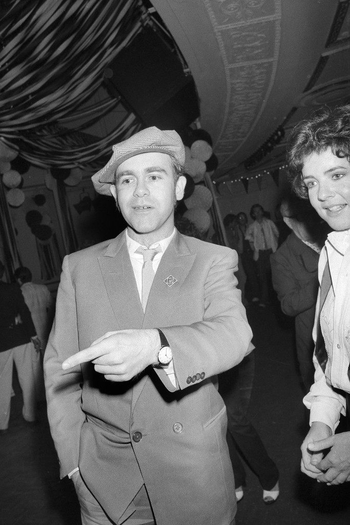 "Rock star Elton John is shown with actress Stockard Channing at New York's Studio 54 disco, June 13, 1978, during a party for the opening of the movie ""Grease"". (AP Photo) Ref #: PA.17642638 Date: 13/06/1978"