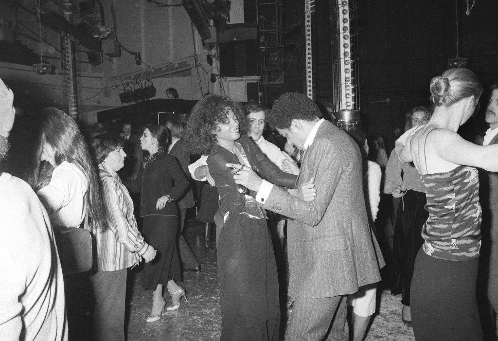Singing star Diana Ross and comedian Richard Pryor dance at Studio 54 in New York, Dec. 16, 1977. (AP Photo)