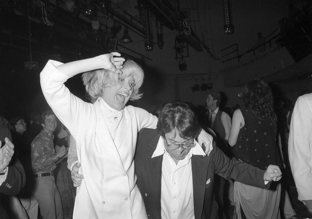"Actress Carol Channing and film producer Allan Carr kick up their heels in animated fashion at New York's Studio 54 during a party for the opening of the movie ""Grease"", June 13, 1978. (AP Photo) Ref #: PA.17642646 Date: 13/06/1978"