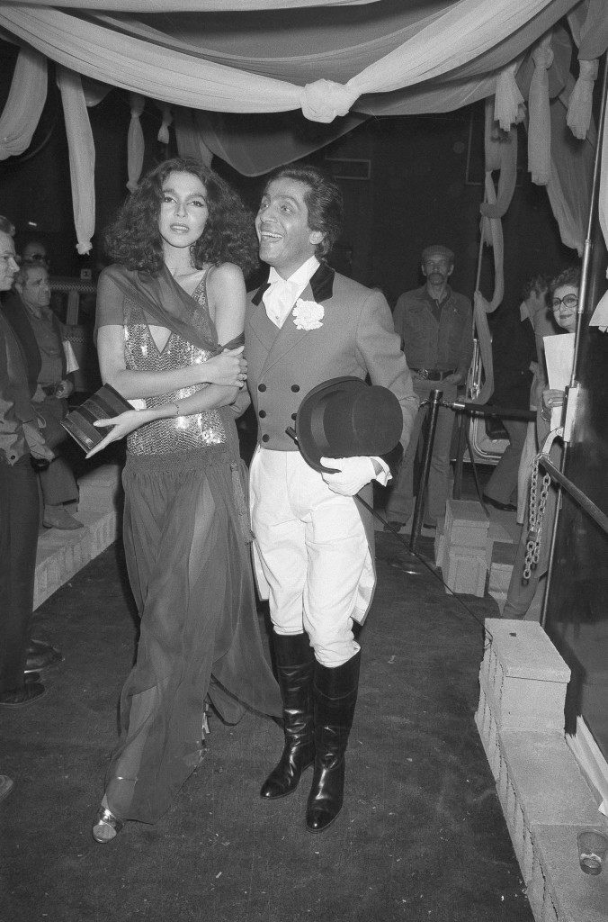 Fashion designer Valentino, dresses as a ringmaster, appears with Brazilian model Dalma at his birthday party at Studio 54 in New York, May 11, 1978. (AP Photo) Ref #: PA.17642656 Date: 11/05/1978