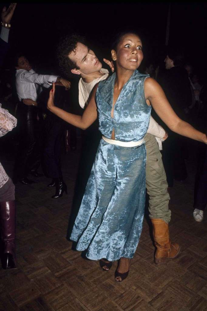 A couple dances back to back on the dance floor of New York's Studio 54, 1977. (AP Photo) Ref #: PA.17645267 Date: 01/01/1977