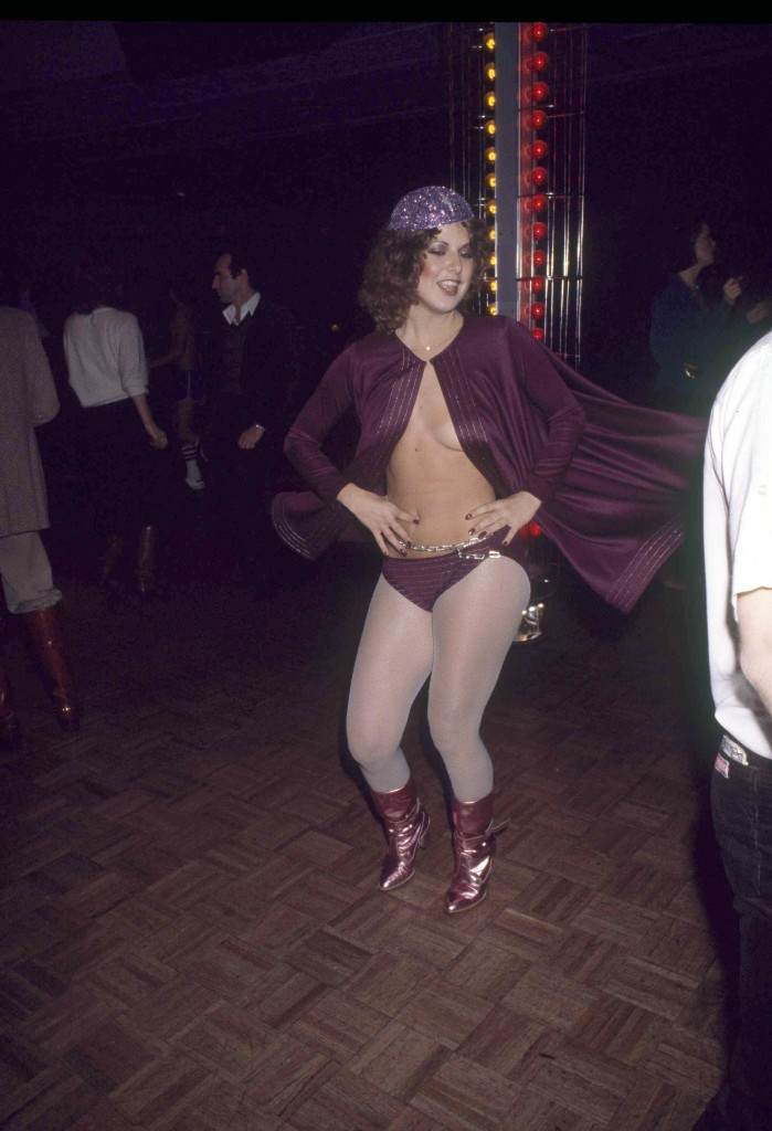 Woman clad in scant purple garments hits the dance floor at New York's Studio 54, 1977. (AP Photo) Ref #: PA.17645269 Date: 01/01/1977