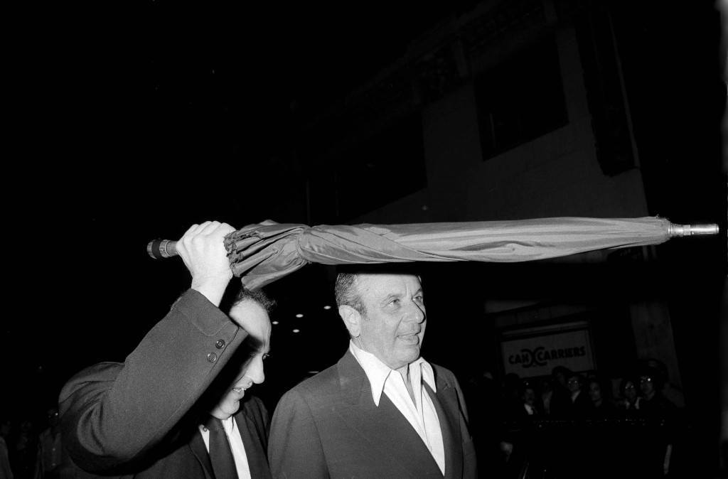 "Former Columbia Pictures president David Begelman, right, is shielded from photographers by a companion as he leaves New York's Studio 54, May 18, 1978. Begelman pleaded ""nolo contendere"" (no contest) in Los Angeles to charges of grand theft of $40,000 from Columbia Pictures. (AP Photo) Ref #: PA.17654472 Date: 18/05/1978"