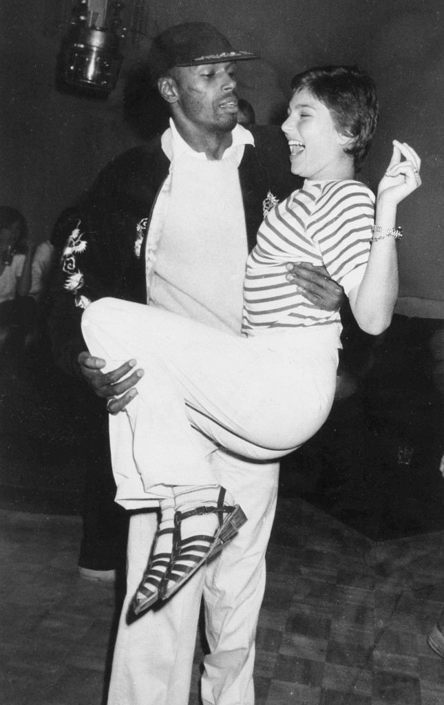 Young actress Tatum O'Neal, daughter of actor Ryan O'Neal, enjoys the ride as dancer Sterling Saint Jacques gives her a lift during an evening of dancing at New York's Studio 54, April 23, 1978. (AP Photo) Ref #: PA.17654490 Date: 23/04/1978
