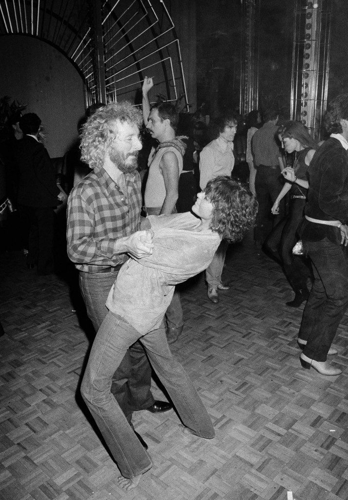 Actress Ali MacGraw and her companion, movie producer Larry Spangler, make the scene at New York's Studio 54, Oct. 10, 1978. MacGraw came, danced and went barefoot. (AP Photo) Ref #: PA.17654499 Date: 10/10/1978