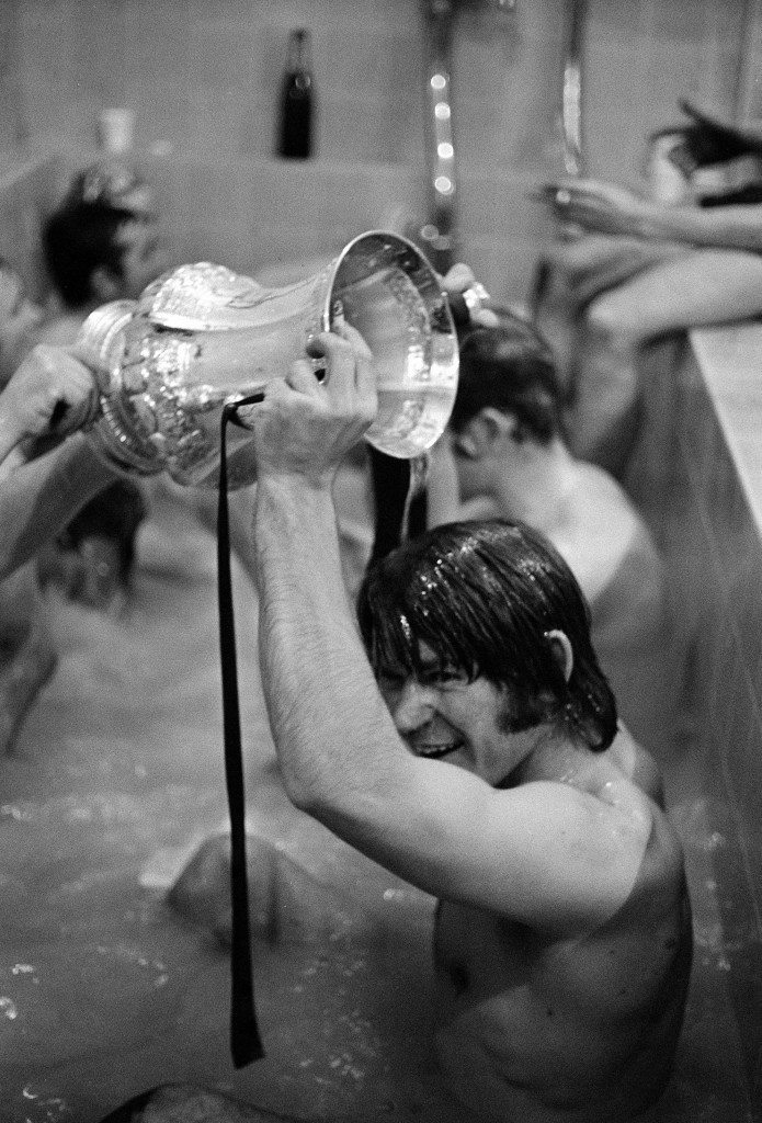 Chelsea's David Webb, scorer of the winning goal in extra time, gets a champagne shower from the FA Cup