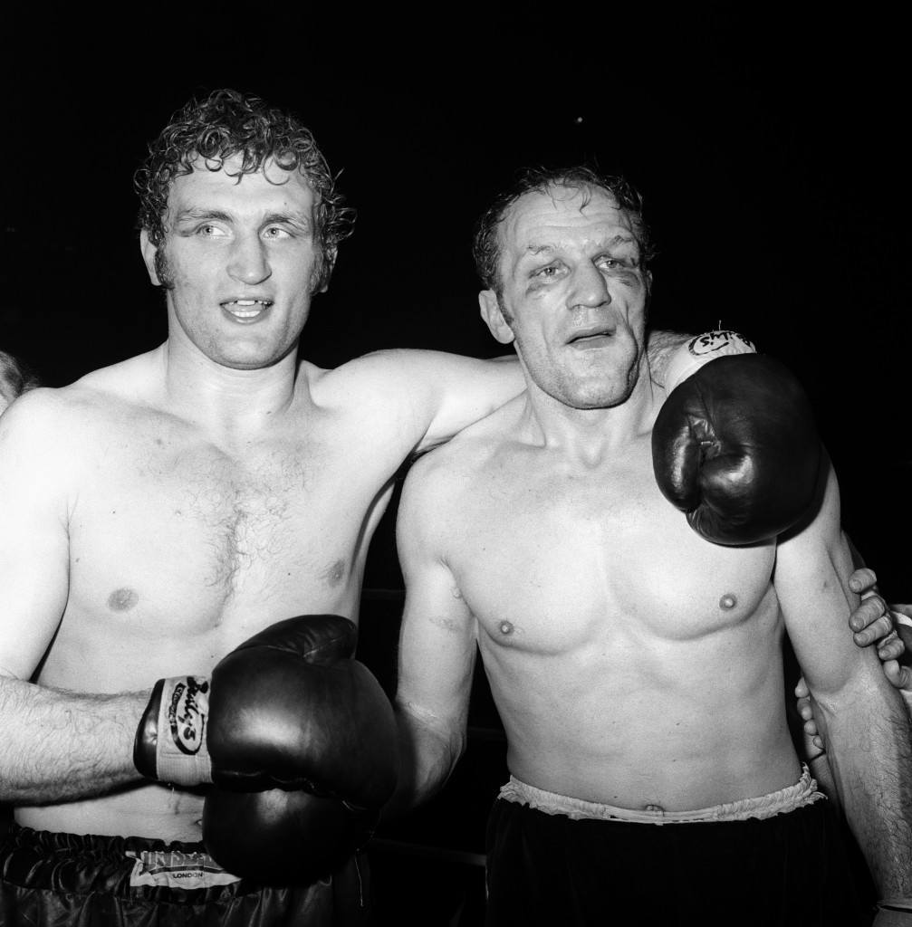 An awesome evening for Joe Bugner, left, who expresses affection for Henry Cooper by placing an arm around him, after he beat him at the Empire Pool on points. Challenger Joe is now the Heavyweight Champion of Great Britain, Europe and the Commonwealth. Ref #: PA.1981359  Date: 16/03/1971