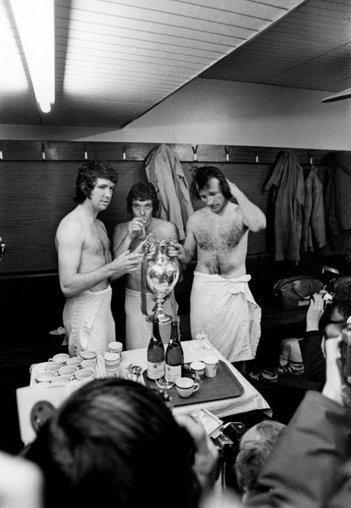 (L-R) Liverpool's Chris Lawler, Ian Callaghan and Tommy Smith celebrate winning the League Championship with a cup of champagne