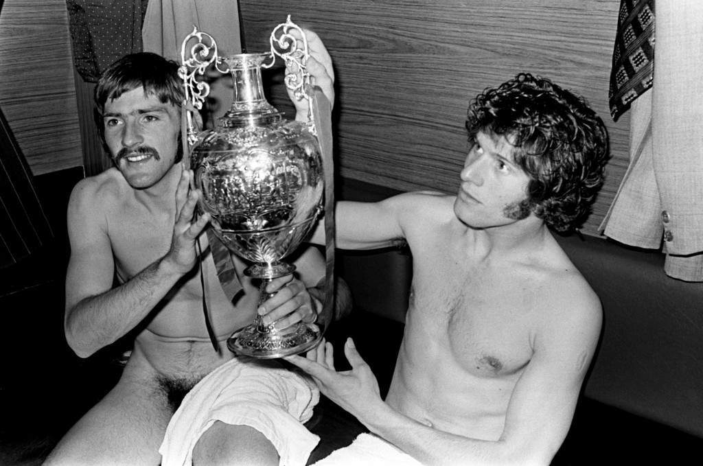 PA. 394244 Soccer - Football League Division One - Liverpool v Leicester City (L-R) Liverpool's Steve Heighway and Phil Boersma celebrate with the League Championship trophy in the Anfield changing room  NULL Ref #: PA.394244  Date: 28/04/1973