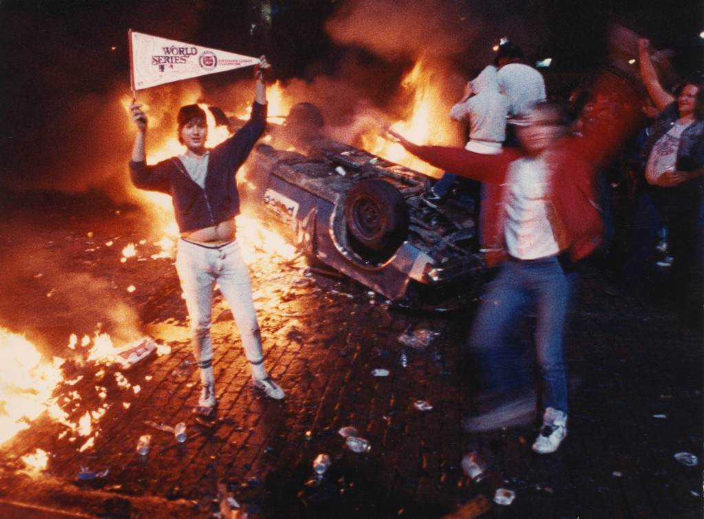 Bubba Helms, left, celebrates after the Detroit Tigers won the 1984 World Series in Detroit in 1984. Detroit erupted into chaos in 1984, following the Tigers' World Series victory over the San Diego Padres. There hasn't been a riot since then, but the image of chaos in Detroit has become so ingrained that officials find it necessary to point out when local fans behave themselves. (AP Photo/Robert Kozloff)