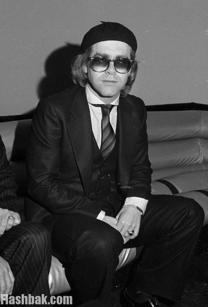 British pop singer Elton John makes a brief appearance at New York's Studio 54.