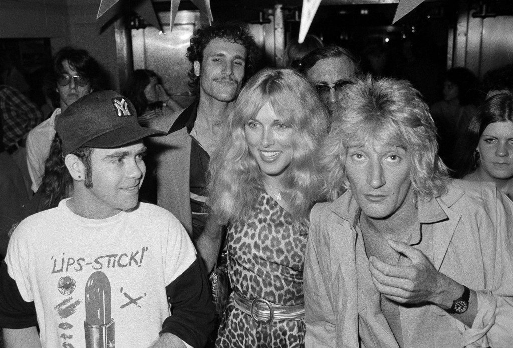 British pop singer Elton John, left, Lana Hamilton, wife of actor George Hamilton, and rock singer Rod Stewart arrive at New York's Studio 54, July 10, 1978, to celebrate at a party given by RCA Records, who signed John to a contract with the recording company. Others are unidentified. Ref #: PA.4400315 Date: 10/07/1978