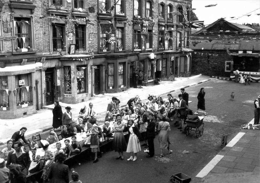 Party in Rillington Place, 6th June 1953 In front of decorated, boarded up 10 Rillington Place, Notting Hill, children settle down to watch an entertainment following their Coronation street party. It was in this house that the bodies of several murdered women were discovered, and a former resident of the house, John Reginald Halliday Christie, is now awaiting trial on charges of murdering two women. Ref #: PA.4875726  Date: 06/06/1953