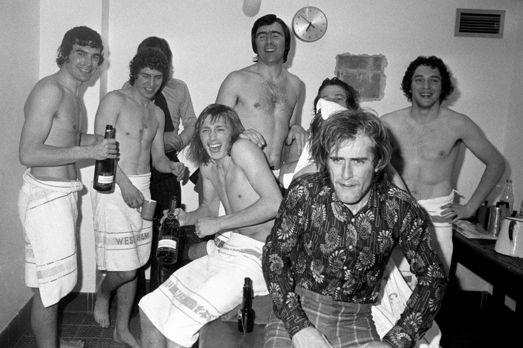 Soccer - FA Cup Semi Final - West Ham United v Ipswich - Upton Park A cause for dressing room celebration at Stamford Bridge by West Ham United players after trhey defeated Ipswich Town. (Left to right) Trevor Brookings, Pat Holland, goalscorer Alan Taylor, Bobby Gould (behind scorer), unidentified player with towel, Graham Paddon (dressed) and John McDowell. Date: 09/04/1975