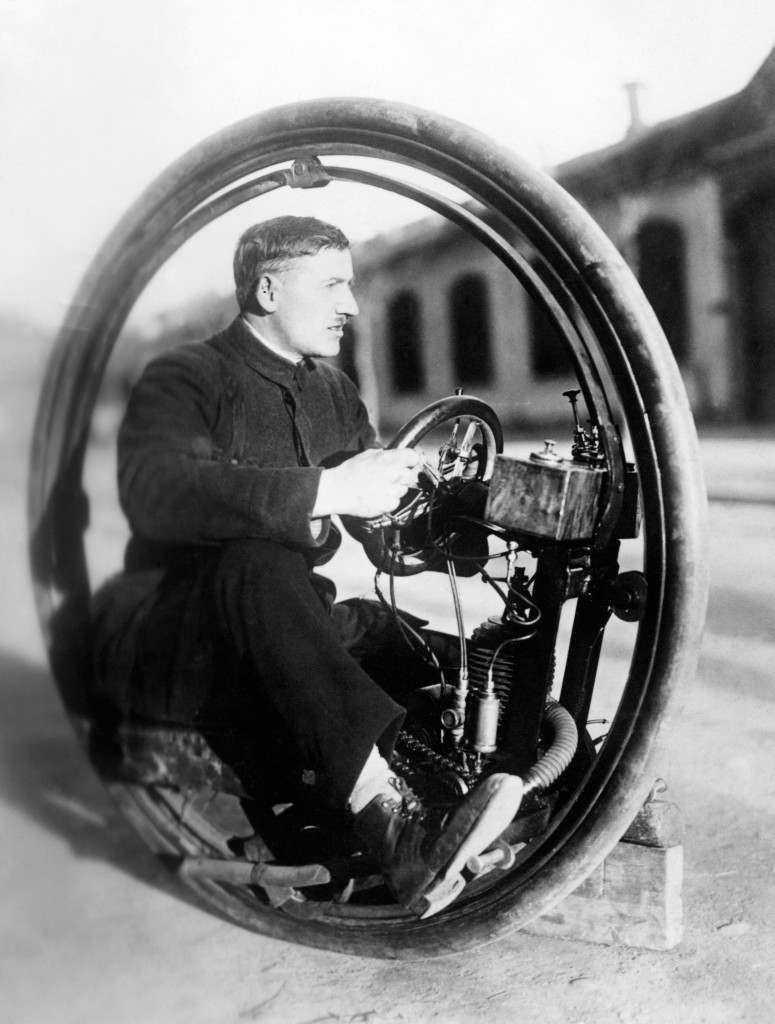 "Signor Davide Cislaghi with his one wheel motorcycle called the ""Monowheel"" which is capable of speeds up to 40 mph. The trials have proved a success and the machine will soon be on the market. Ref #: PA.5504300  Date: 01/01/1923"
