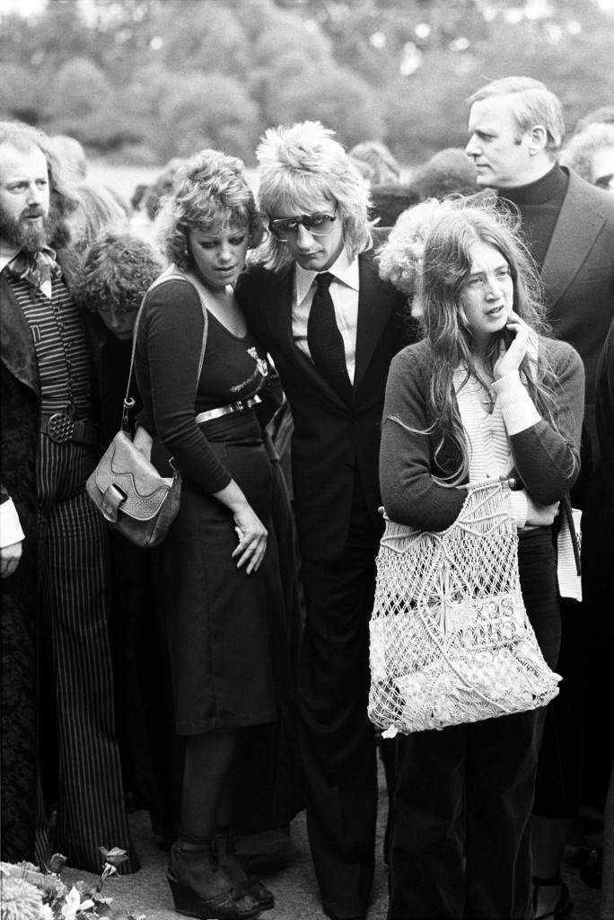 Rod Stewart with a friend at Golders Green Crematorium where he paid his last respects to fellow pop singer Marc Bolan Ref #: PA.5534972  Date: 20/09/1977