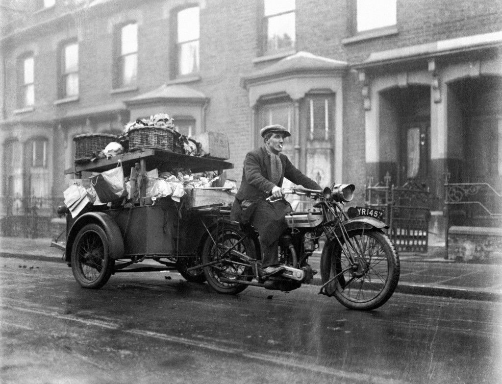 A Greengrocer enjoys a cigarette as he drives down the street with his London 'shop'. Ref #: PA.5765714  Date: 02/02/1929