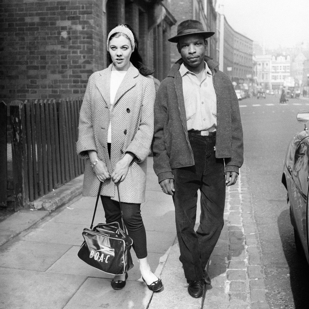 A West Indian man and his white girlfriend walk through the streets of Notting Hill Gate despite the threat from right-wing thugs following the race riots in the area. Ref #: PA.5969196  Date: 02/09/1958