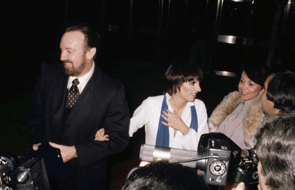 Liza Minnelli with her husband Jack Haley, Jr. at party in honor of Bianca Jagger given by designer Halston at Studio 54 in New York City on December 12, 1977. Minnelli is talking to unidentified guests at the party. (AP Photo/Ron Frehm) Ref #: PA.6167316 Date: 12/12/1977