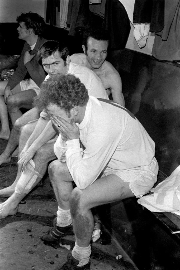 PA. 719780 Soccer - FA Cup - Semi Final Second Replay - Manchester United v Leeds United An exhausted Billy Bremner of Leeds United recovers in the dressing room after scoring the winning goal, to the delight of teammates Paul Reaney (r), Terry Cooper (behind Bremner) and Gary Sprake (top l) Ref #: PA.719780  Date: 26/03/1970