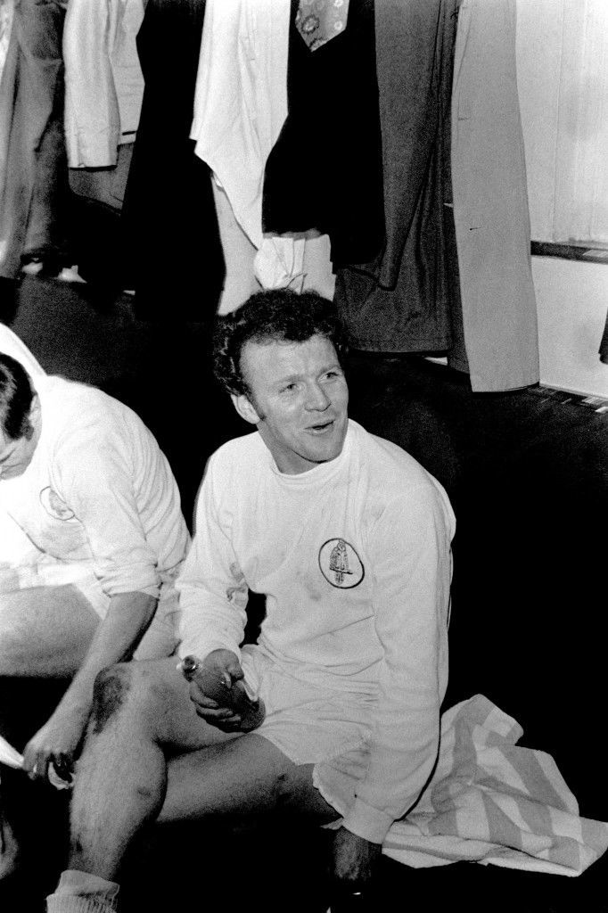 Leeds United's Billy Bremner has a celebratory drink in the dressing room after the match, in which he scored the winning goal