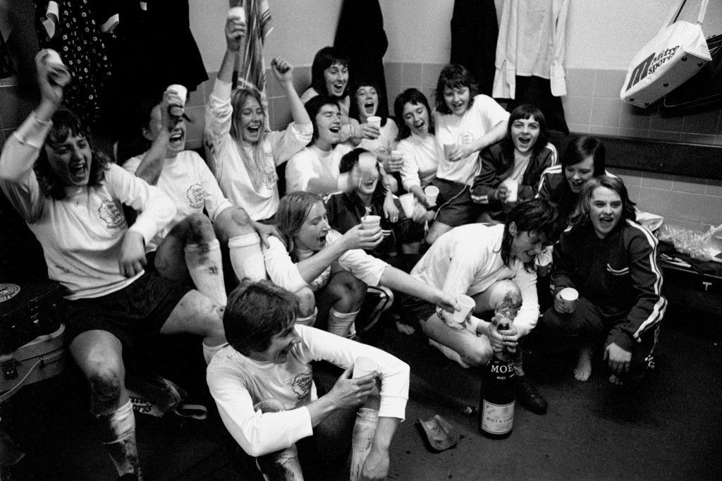 omen's Soccer - Friendly - England v France England players celebrate their 2-0 victory with a bottle of champagne in the dressing room after the match Ref #: PA.747518  Date: 09/11/1974