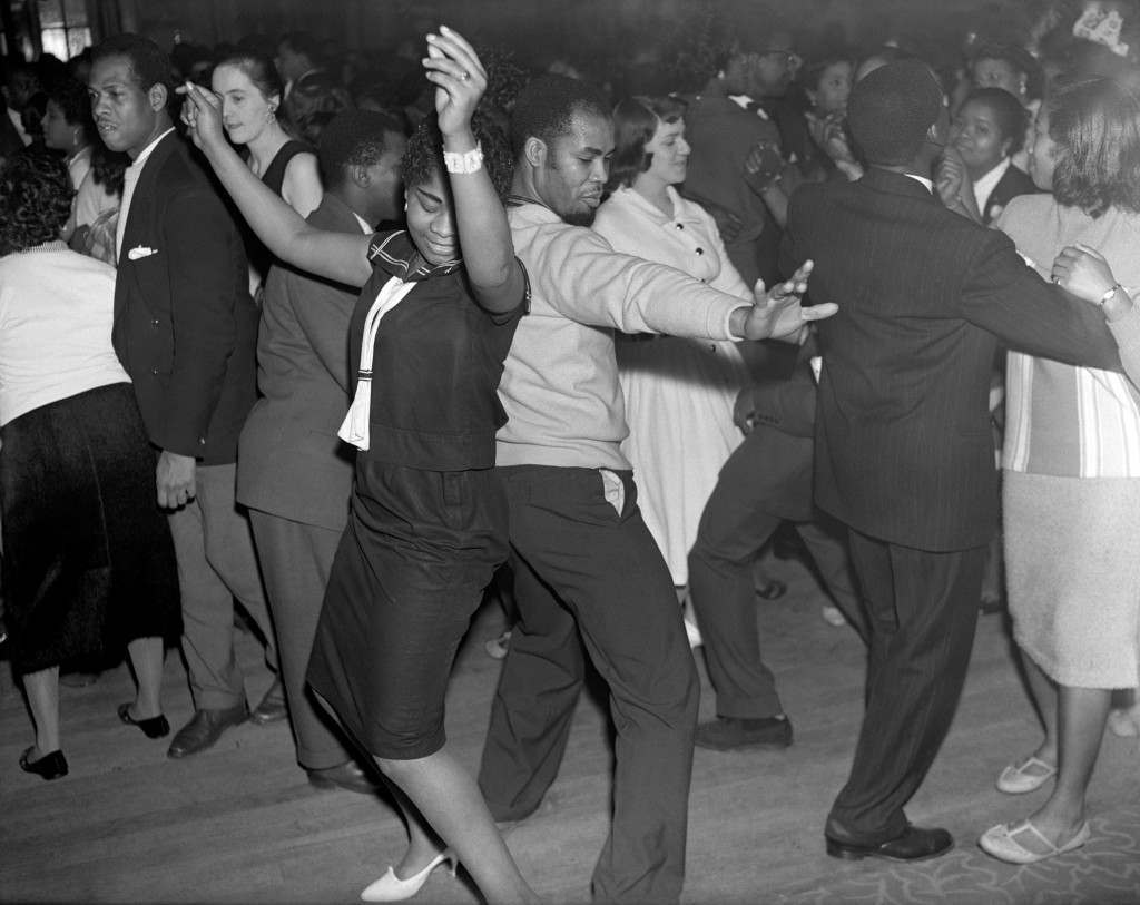 Guests dancing to the music of the Trinidad All Star Steel Band at the Caribbean Carnival at St Pancras Hall, London. Ref #: PA.7694473  Date: 30/01/1959