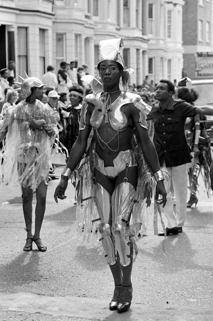 Resplendent in her metal outfit this maiden from an 'armoured regiment' marches in the Notting Hill Carnival in London, day two of the August Bank holiday festival. Ref #: PA.7740090  Date: 30/08/1982