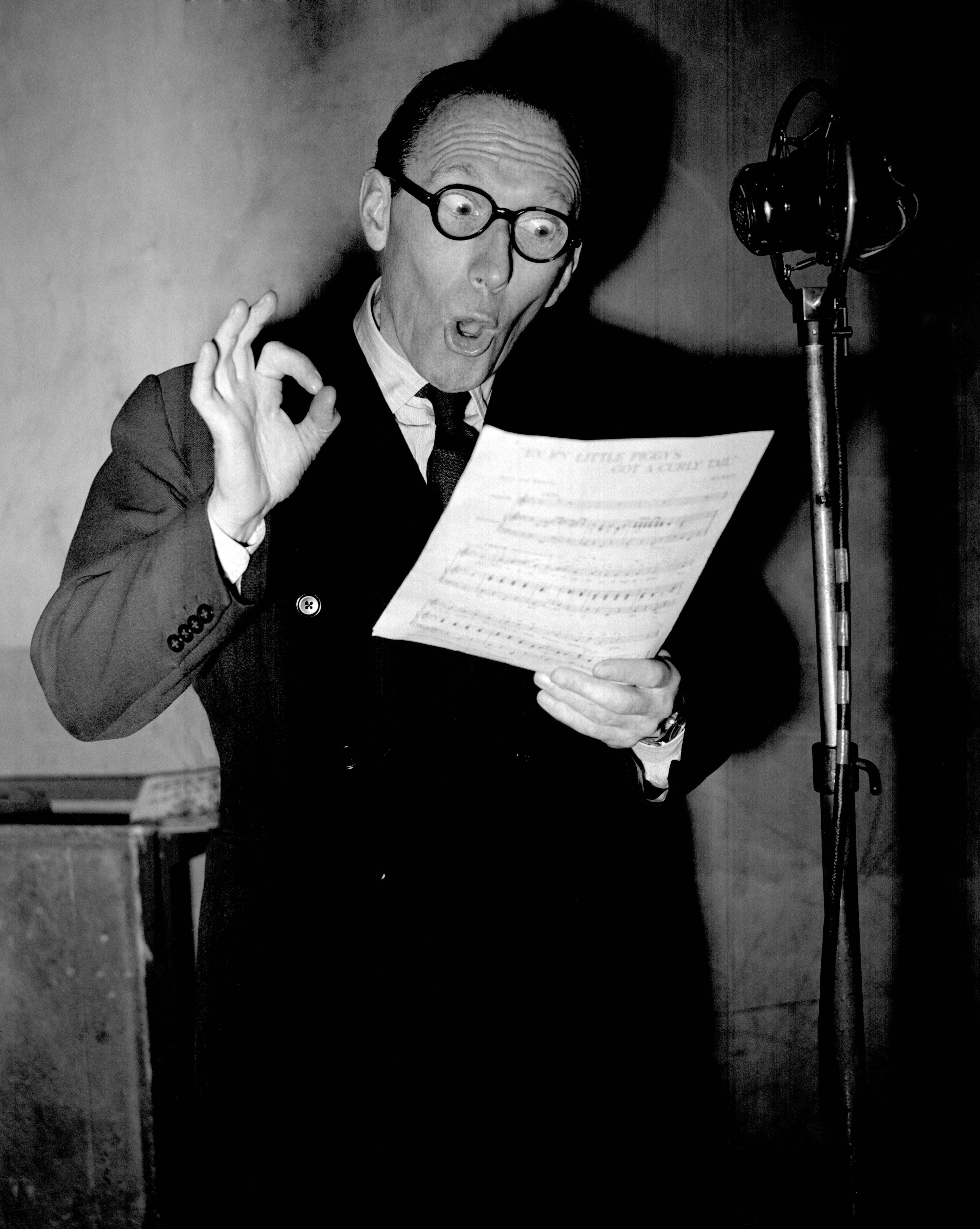 The popular radio and stage comedian Arthur Askey at the microphone at the EMI Studios in Abbey Road, north west London.