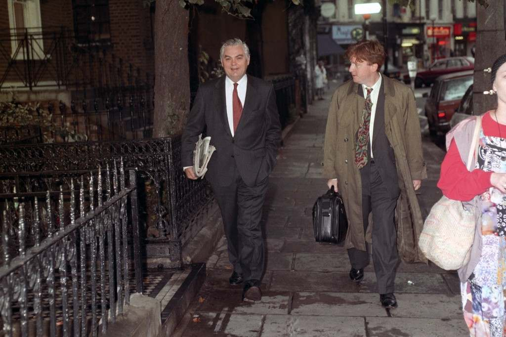 NORMAN LAMONT RETURNING TO HIS HOME IN NOTTING HILL WITH THE NEWSPAPERS IN WHICH HE COMMENTS ON THE CURRENT POLITICAL SITUATION. IT IS A YEAR TO THE DAY SINCE 'BLACK WEDNESDAY', THE DAY NORMAN LAMONT, THEN CHANCELLOR, ANNOUNCED BRITAIN WOULD LEAVE THE ERM. (European Exchange Rate Mechanism). Ref #: PA.821910  Date: 16/09/1993