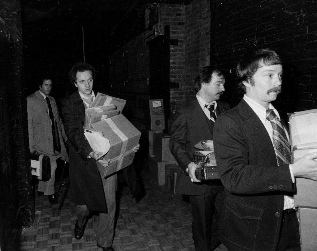 Federal agents carry boxes of files and records from New York nightclub Studio 54, Thursday, Dec. 14, 1978. An Internal Revenue Service (IRS) spokesman said the books had been seized in connection with an undisclosed investigation. The owners of the nightclub were charged with tax evasion. (AP Photo) Ref #: PA.8631115 Date: 14/12/1978