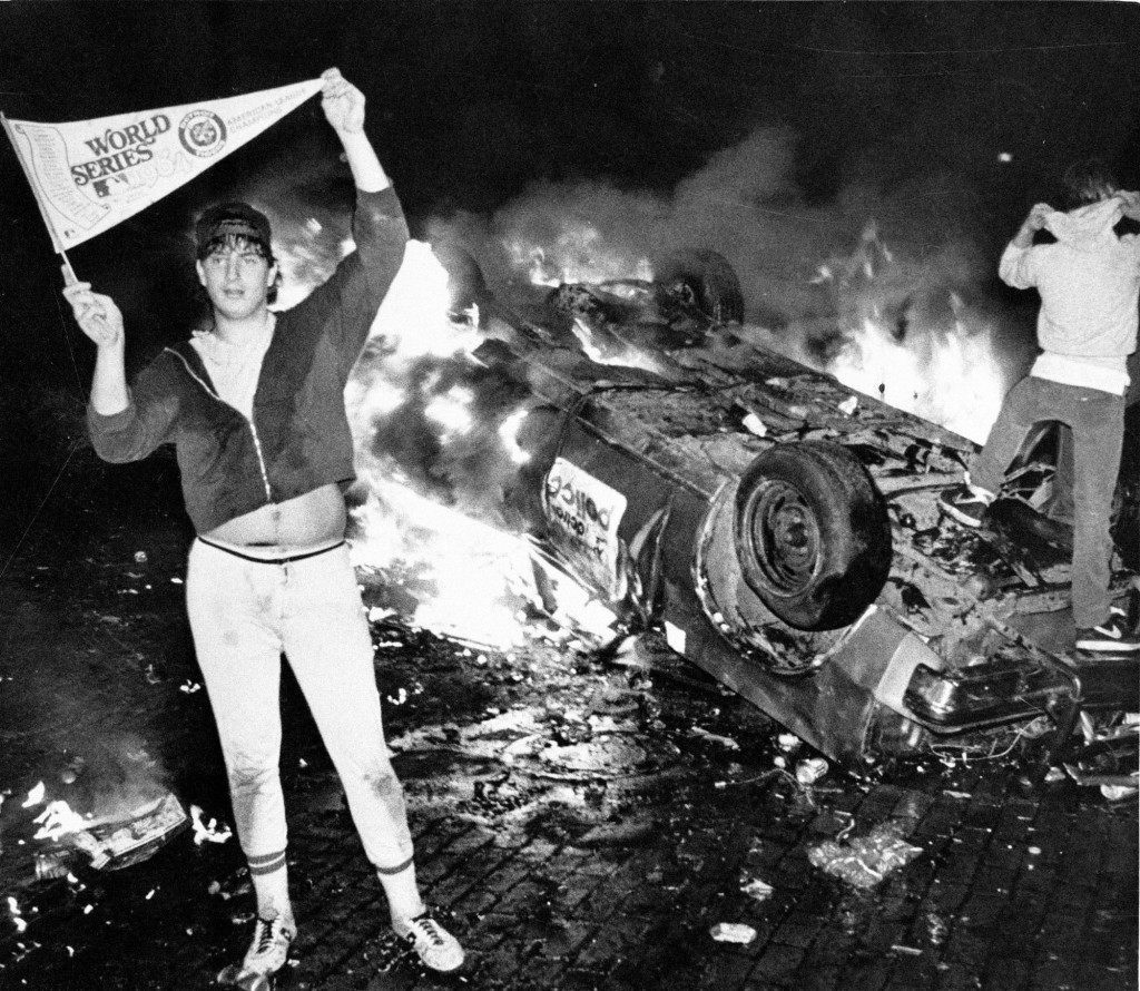 Bubba Helms stands next to a burning Detroit police car after the Detroit Tigers beat the San Diego Padres to win the 1984 World Series in Detroit. Helms became a folk hero of sorts; two weeks after the Tigers won, a number of people came to Detroit-area Halloween parties dressed like him. The rest of his life, though, would be marked by failure, drug addiction, mental illness and a broken marriage. (AP Photo/Joe Kennedy) Ref #: PA.8652868  Date: 01/01/1984