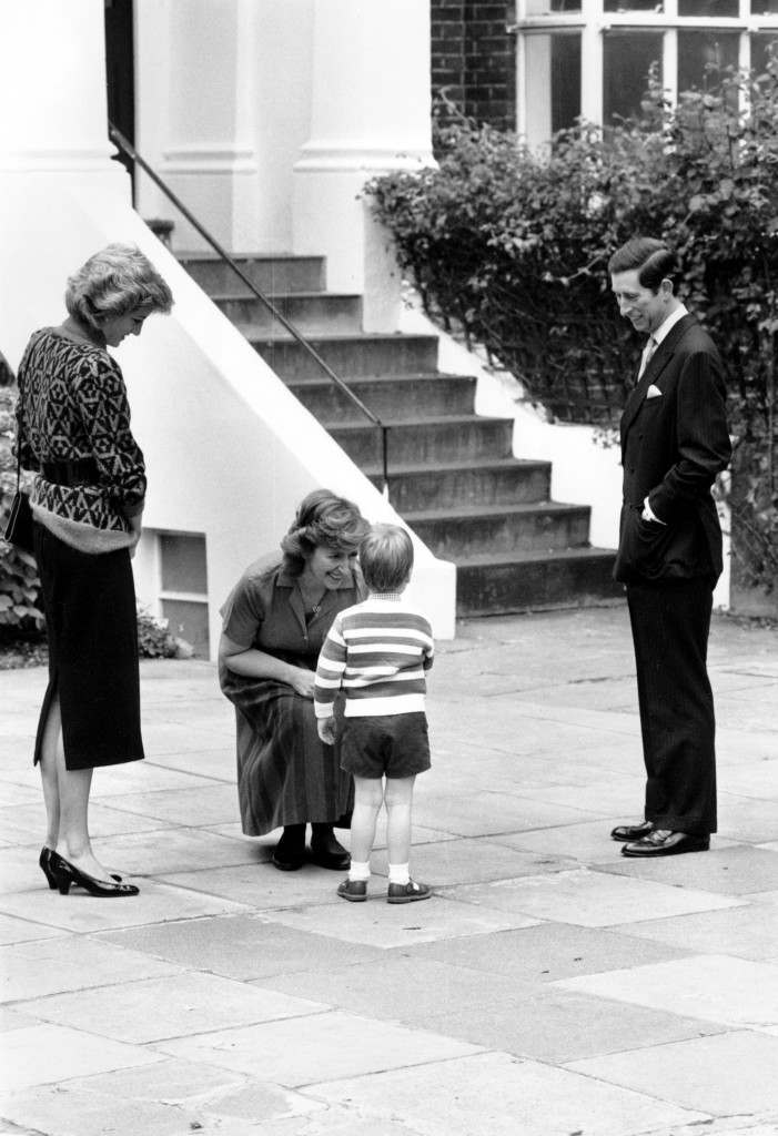 Jane Mynors welcomes Prince William on his first day of school at her private kindergarten as his parents, Princess Diana, left, and Prince Charles watch in Notting Hill, London, England, Tuesday, Sept. 24, 1985. The three-year-old Prince is the first heir to the British throne to receive his pre-school education at a private kindergarten. (AP Photo/Redman) Ref #: PA.8684153  Date: 24/09/1985