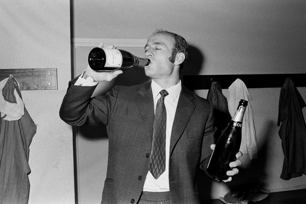 Norwich City manager Ron Saunders celebrates winning the Second Division Championship in the dressing room.