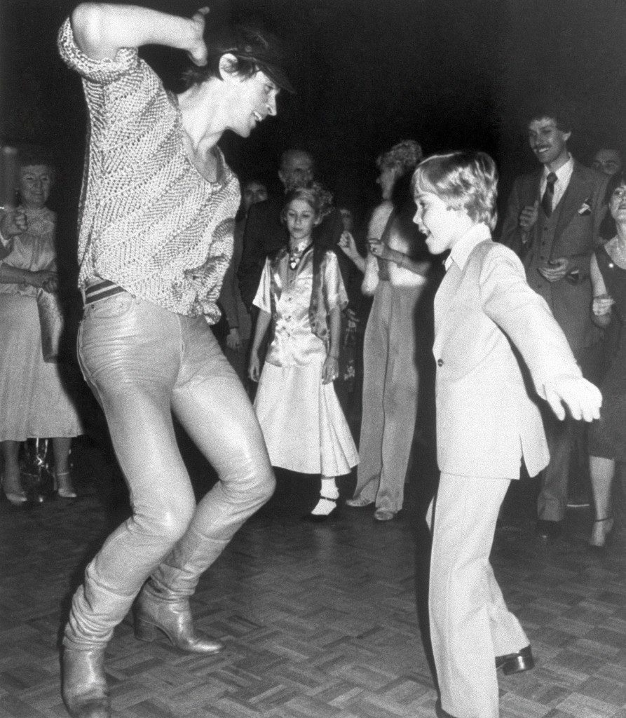 "Dancer Rudolf Nureyev initiates nine-year-old Ricky Schroder into the delights of disco dancing at Studio 54 in New York on Sunday, April 2, 1979. Ricky had previously attended the preview of the remake of ""The Champ"" in which he stars with Jon Voight. (AP Photo/Quinto) Ref #: PA.9175553 Date: 02/04/1979"