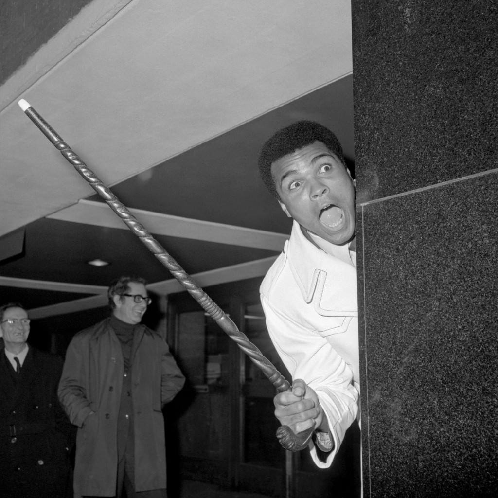 Muhammad Ali looks round at the welcome he receives at Heathrow Airport. He is in London to see the fight between Joe Bugner and Santiago Alberto Lovell at the Royal Albert Hall. Ref #: PA.9269535  Date: 29/11/1974