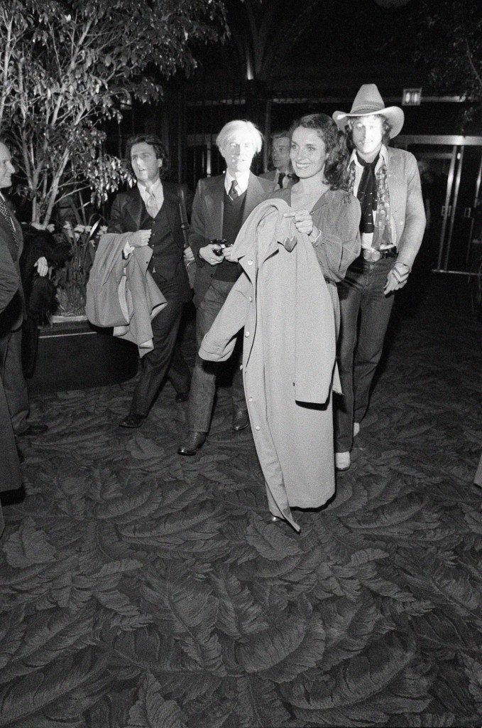 Celebrities gather at Studio 54 in New York to watch the Academy Awards on giant screen television, April 4, 1978. Margaret Trudeau arrives with Andy Warhol. (AP Photo/G. Paul Burnett) Ref #: PA.9730382 Date: 04/04/1978