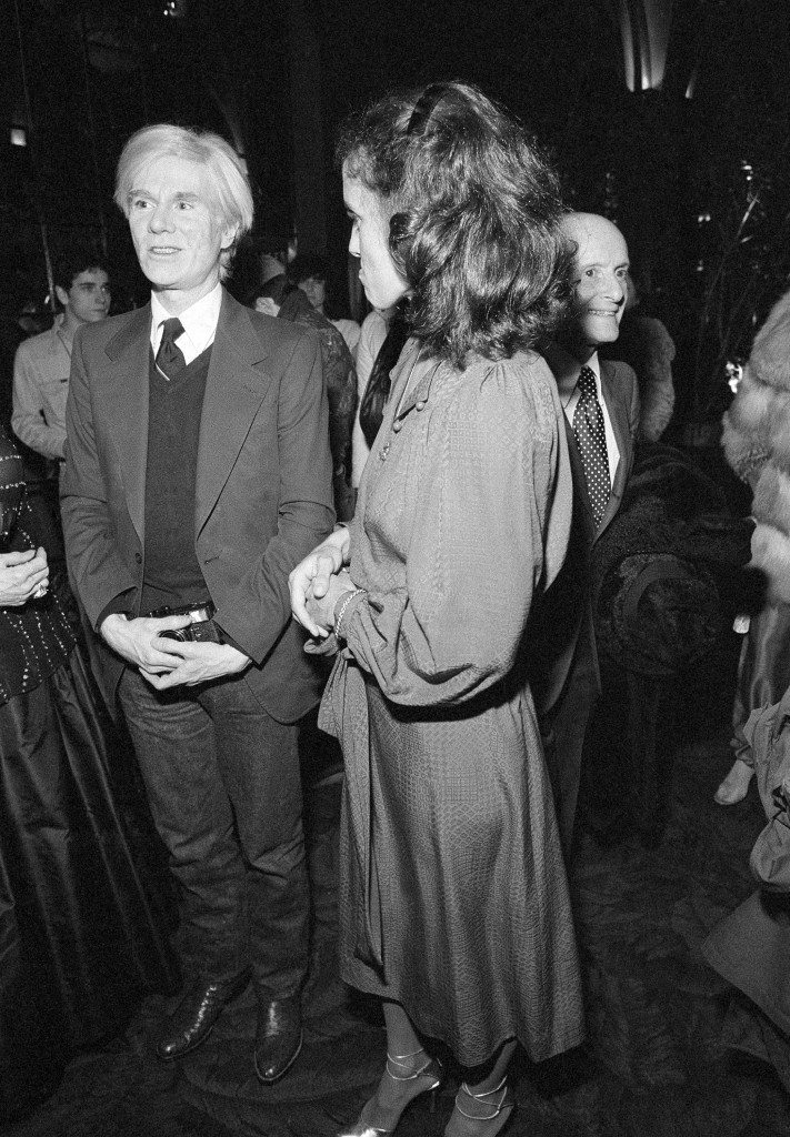 Celebrities gather at Studio 54 in New York to watch the Academy Awards on giant screen television, April 4, 1978. Margaret Trudeau arrives with Andy Warhol. (AP Photo/G. Paul Burnett) Ref #: PA.9730410 Date: 04/04/1978