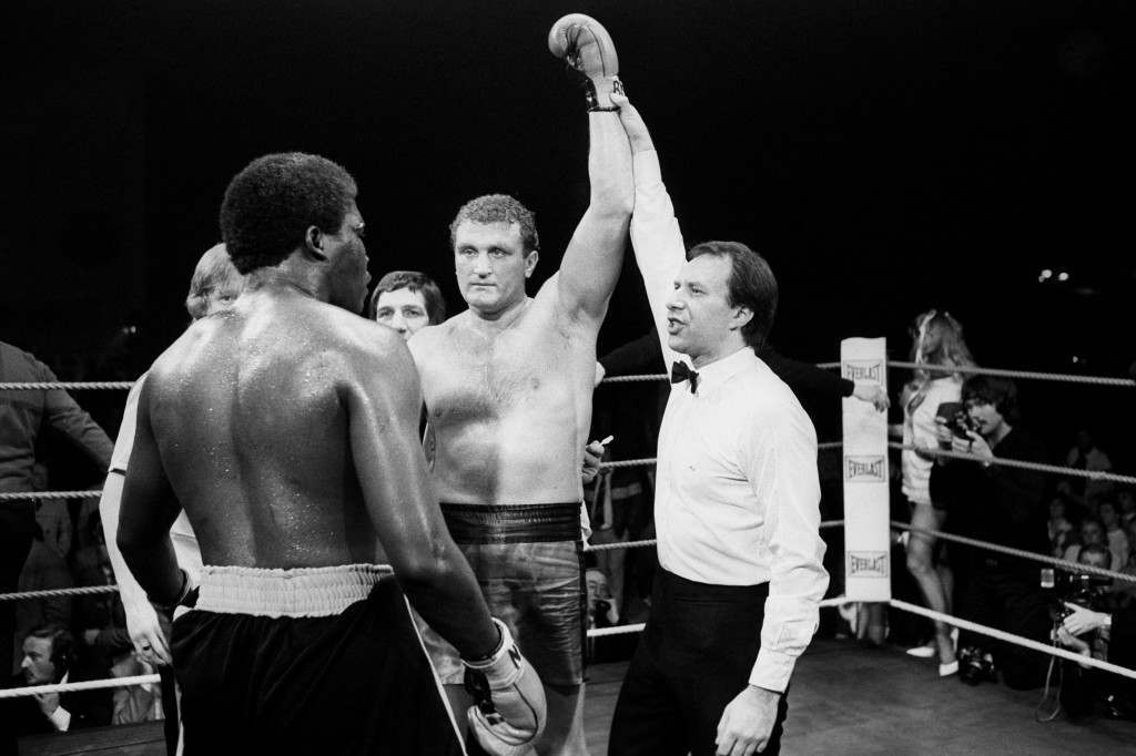 Boxing - Heavyweight - Joe Bugner v Danny Sutton - Alexandra Pavilion, London Referee Mike Jacobs raises Joe Bugner's arm to declare him the winner after he had stopped American heavyweight Danny Sutton in the ninth round. Ref #: PA.9781453  Date: 20/04/1983