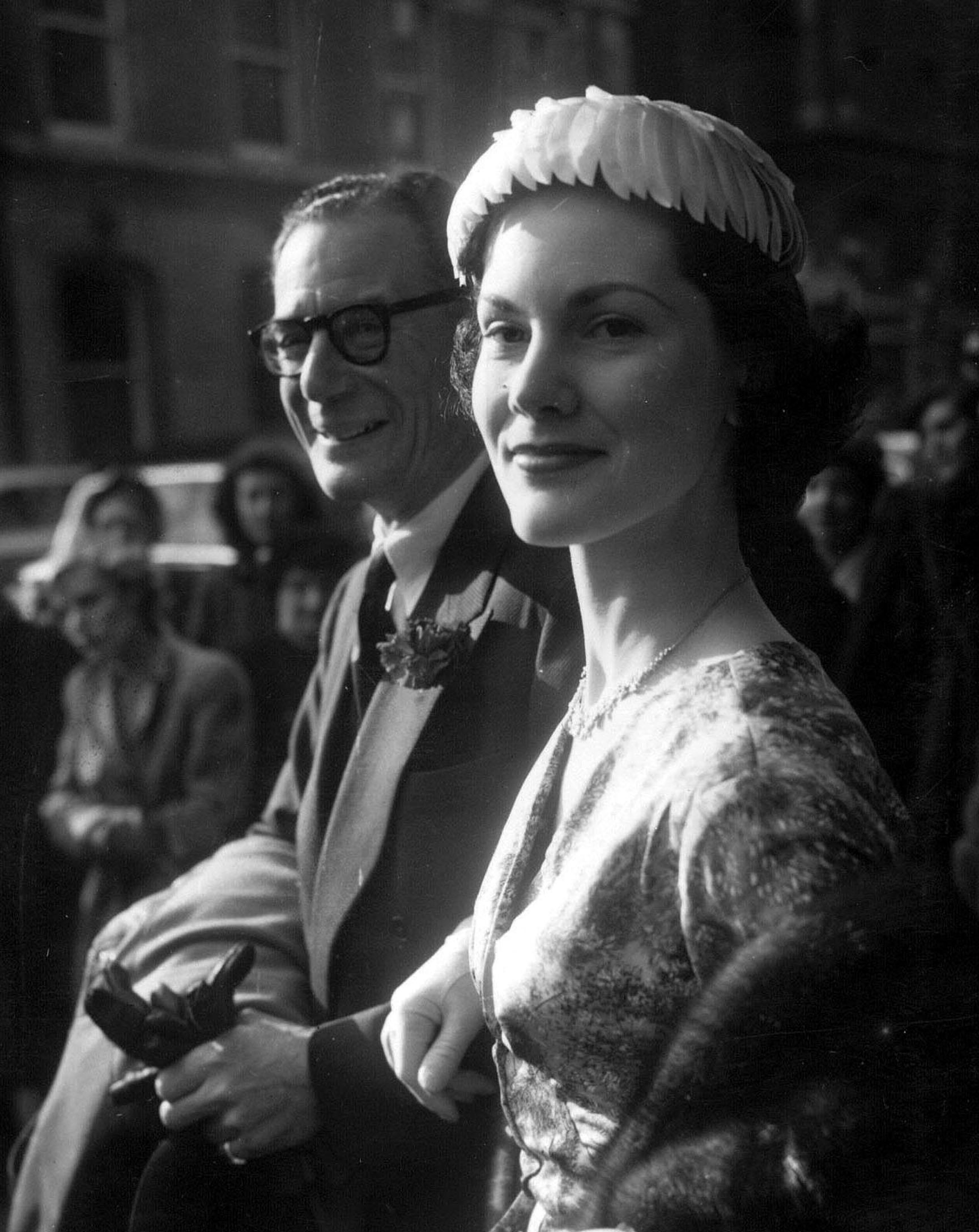 Val Gielgud, 54, head of BBC sound drama, with his new bride, actress Monica Grey, 24, leaving Caxton Hall in London, after their wedding on 10 February 1955.