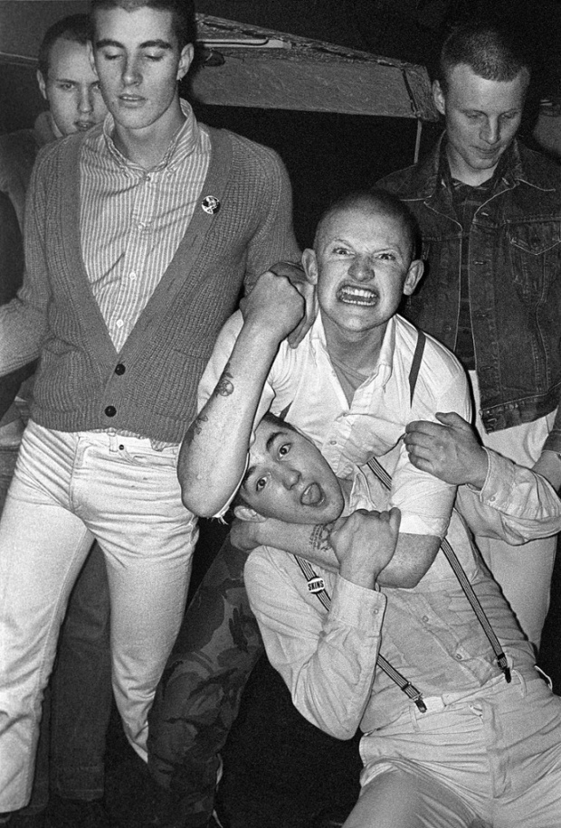 Photographed in Billys, at 69 Dean Street, Soho 1979. This was my first encounter with any skinheads since the early 70s and Wally, the guy waving a fist, was the guy that persuaded me to hang out with them and take more photos. Photograph: Derek Ridgers