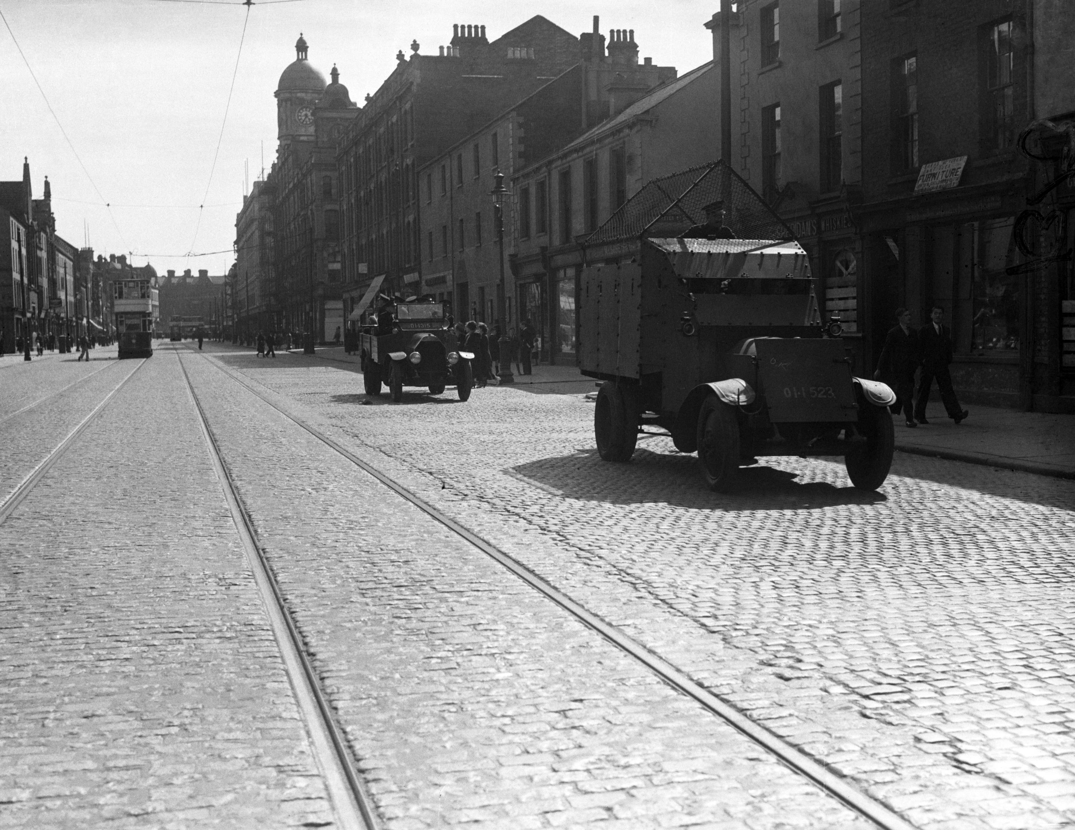 An armoured car fitted with wire netting to protect the crew patrolling a street in Belfast. Fresh trouble broke out in Belfast on July16, 1935 when a man was wounded by a bullet at the funeral of James Lyttle, an Orangeman killed during Saturday's shooting. A street battle followed and many people were injured and three houses burned down. A detachment of military and armoured cars were rushed to the scene to quell the disturbance. (AP Photo/BEAD)